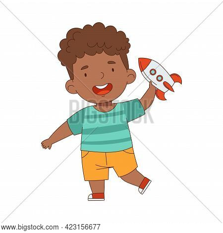 Little African American Boy Playing With Rocket Toy Having Fun On His Own Enjoying Childhood Vector