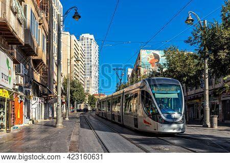 JERUSALEM, ISRAEL - JULY 14, 2019: View of empty Jaffa street and urban light rail system tram -  modern  urban rail transit built in 2010 in Jerusalem.