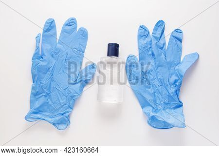 Alcohol Liquid Sanitizer And Blue Medical Gloves For Medical Purpose And Anti Coronavirus Covid-19 O