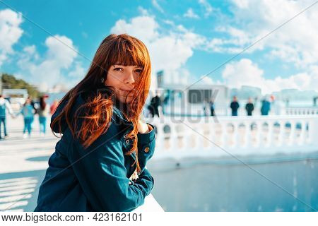Vacation At The Sea. Portrait Of A Beautiful Smiling Woman Leaning On A Balustrade.