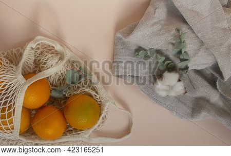 Eco Friendly Lifestyle Concept. Oranges In An Eco-friendly String Bag