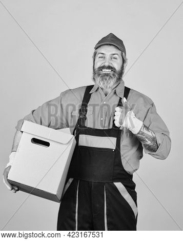 Higher Quality Of Living. Move To New Apartment. Bearded Loader In Uniform. Cardboard Boxes - Moving