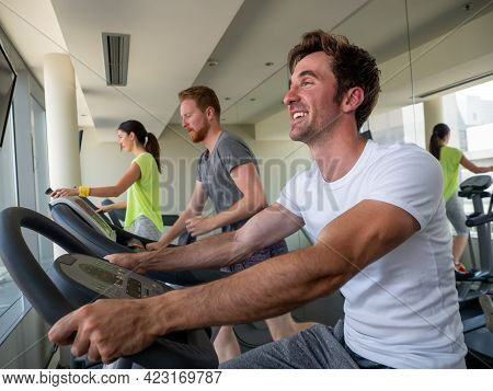 Group Of Young Friends Doing Exercises In Gym