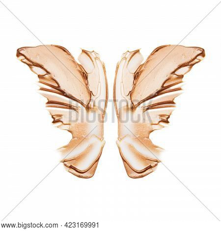 Light Beige Butterfly Smear Of Highlighter Or Luminizer Isolated On White Background.