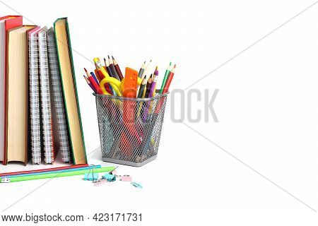 School Or Home School Concept. School Supplies And Textbooks On A White Background. Place For Text,