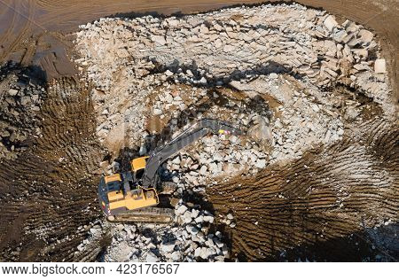 Recycling Concrete And Construction Waste From Demolition. Excavator At Landfill Of The Disposal. Re
