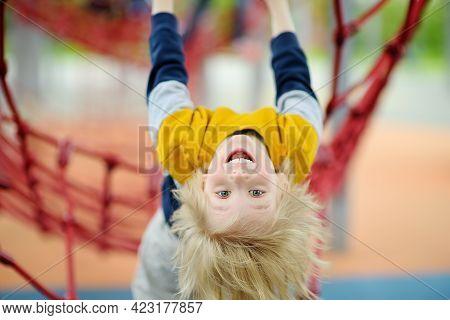 Cute Perky Preschooler Boy Having Fun On Outdoor Playground. Spring/summer/autumn Active Sport Leisu