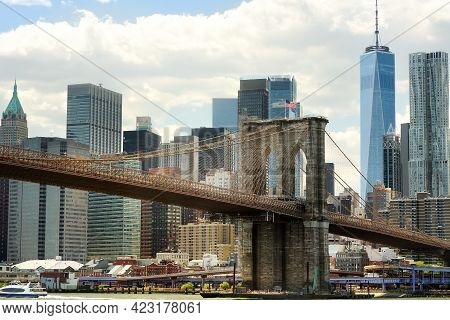Famous Brooklyn Bridge On The Background Of Skyscrapers Of Manhattan. Postcard View Of New York, Usa