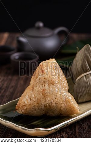 Zongzi. Rice Dumpling For Dragon Boat Festival On Dark Wooden Table Background.