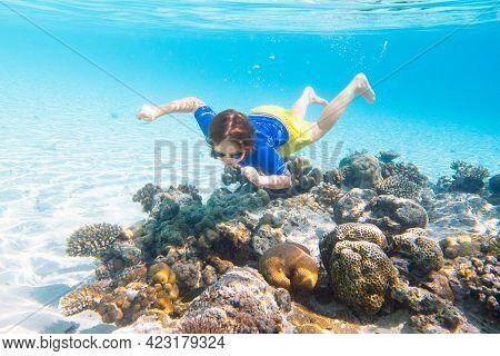 Child Snorkeling. Kids Swim Underwater. Beach And Sea Summer Vacation With Children. Little Girl Wat