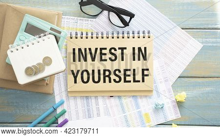 A Workplace With A Large Inscription, Invest In Yourself. The Concept Of Personal Or Business Develo