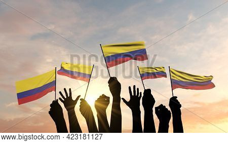 Silhouette Of Arms Raised Waving A Colombia Flag With Pride. 3d Rendering