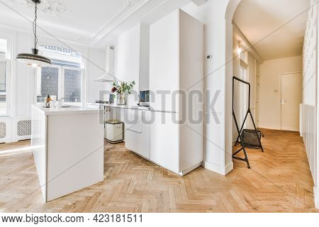 Modern Galley Kitchen With Wooden Cabinets And Minimalist Design In Studio Attic Apartment With Whit