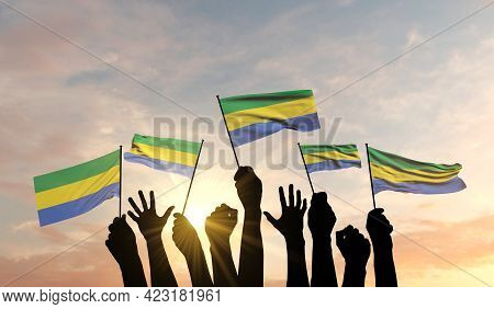 Silhouette Of Arms Raised Waving A Gabon Flag With Pride. 3d Rendering