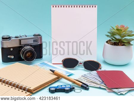 Glasses, Notepad, Pen, Camera, Money, Cash, Passports And Blank Vertical White Notepad For Your Lett