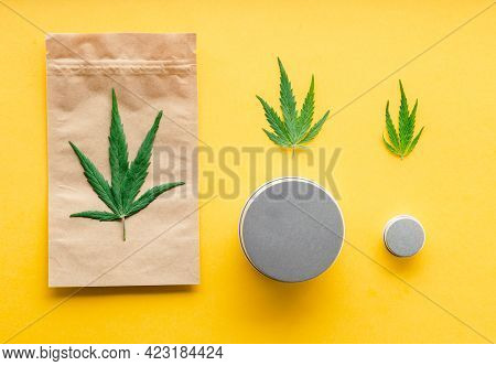 Craft Package With Cannabis Leaf And Metal Jars. Different Sizes Of Cannabis Packages, Weed Trade Le