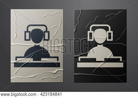 White Dj Wearing Headphones In Front Of Record Decks Icon Isolated On Crumpled Paper Background. Dj