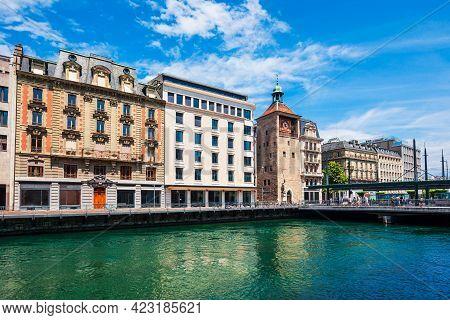 Tour De L'ile Is A Clock Tower Located On The Bel Air Bridge In Geneva City In Switzerland