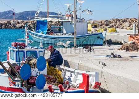 Koufonisi Island, Cyclades, Greece. Moored Fishing Boats At Dock Background.