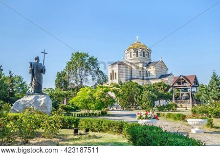 Panorama Of Saint Vladimir Cathedral And Its Belfry. Statue Of Andrew The Apostle In The Garden. Sho