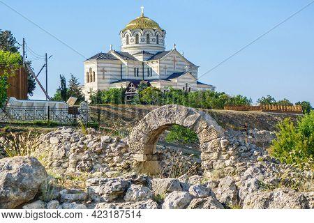 Ruins Of Antique City Chersonesus, Sevastopol, Crimea. Saint Vladimir Cathedral Is On Background