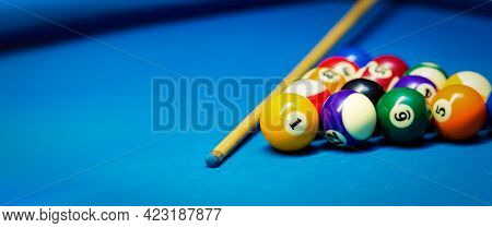 Billiard Pool Balls Rack And Cue On The Blue Cloth Table. Banner Copy Space