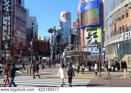 Tokyo, Japan - December 3, 2016: People Visit Hachiko Crossing In Shibuya Ward Of Tokyo.tokyo Is The