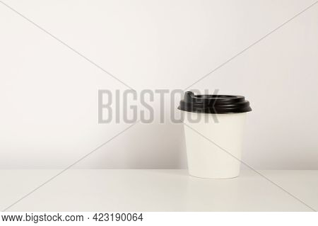 Coffee Cup Mockup On The White Background. Empty Cup For Americano On The Table With Copy Space.
