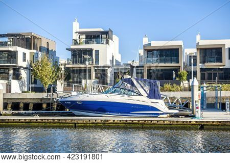 Melbourne, Australia - May 17, 2019: Luxury Waterfront Apartments And Moored Boat Viewed From The Ya