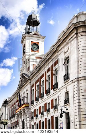Beautiful Perspective Of The Clock Tower Of The Main Square In Madrid Called Puerta Del Sol In A Sun