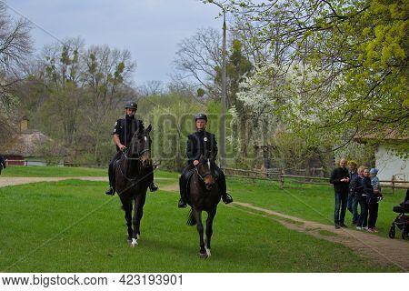 Kyiv Ukraine - May 02 2021: Two Police Officers On Horseback Patrol The Park Area. Worldwide Epidemi