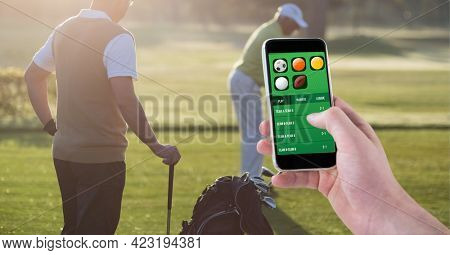 Composition of man using smartphone with sports app over two golf players. sport and competition concept digitally generated image.