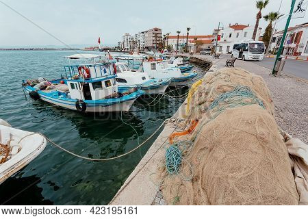 Ayvalik, Turkey: Embankment Of A Turkish Town With Moored Fishing Boats, And Nets Drying Before Fish