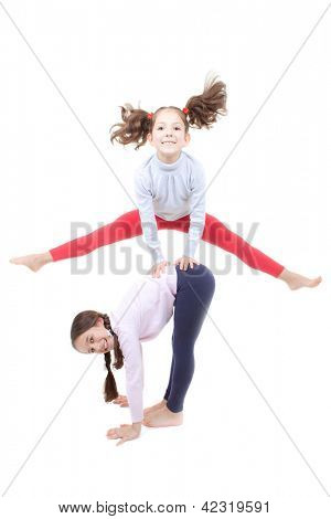 active children playing leapfrog and jumping