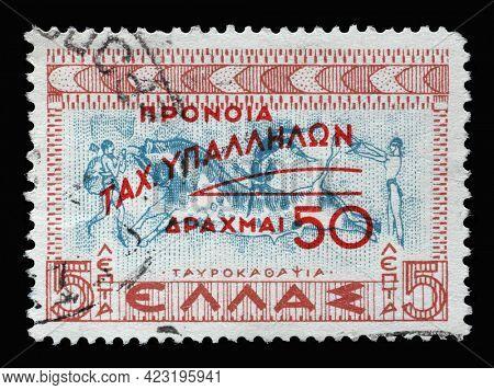 ZAGREB, CROATIA - JUNE 25, 2014: Stamp printed in Greece shows Tavrokathapsia, Bulls' race, Minoan Crete, Postal Staff Welfare Fund, circa 1951