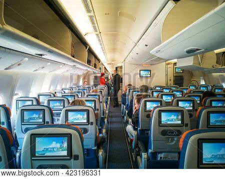 Moscow,russia-june 03,2021:aircraft Cabin Interior,travel Passenger Seat With Monitor Screens.people