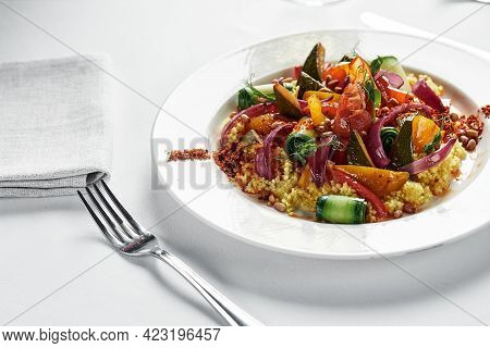 Vegetable Stew With Zucchini, Tomatoes And Bell Pepper In A Creamy Sauce In A Plate, On A White Plat