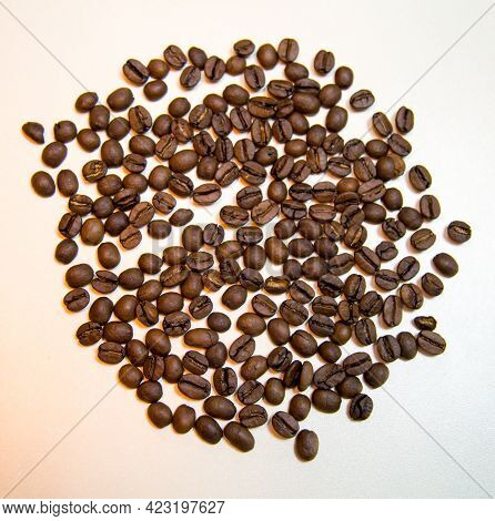 Coffee Beans Are Brown On A White Background. Confectionery Products Drinks Tea Coffee