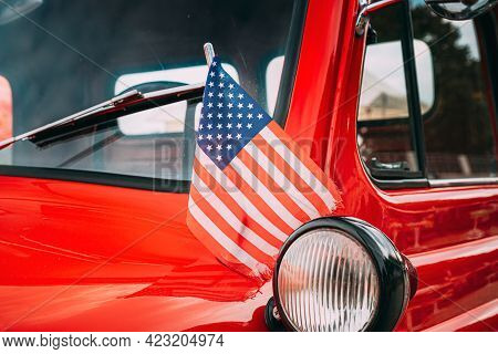 Close Side View Of Red Pickup Truck With Small American Flag Waving. Close Side View Of Red Pickup T