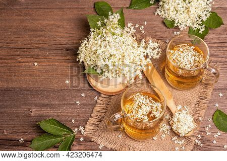 Elderberry Flower Tea. Refreshing Summer Drink, Healthy Lifestyle Concept. Sackcloth Napkin, Vintage