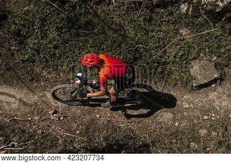 Top View Male Athlete On Mountain Bike Biking On Trail