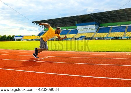 Attractive Fit Afro American Man Running Fast Along Stadium During Championship, Black Man Doing Tra