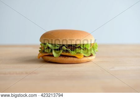 Hamburger Or Cheeseburger Closeup On A Wooden Background