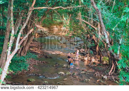 A Group Of Children Are Walking To Explore The Nature Of The Stream At Hin Dad Hot Spring In Kanchan