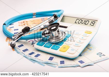 Coronavirus Epidemic And Its Financial Consequences. A Calculator With The Text Covid-19 Close Upcor