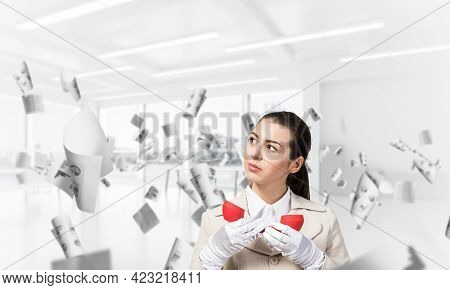 Attractive Woman Holding Vintage Red Phone In Office With Flying Paper Documents. Elegant Operator I