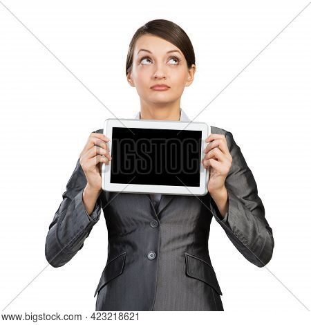 Businesswoman With Tablet Computer Looking Upwards. Portrait Of Attractive Woman In Formalwear Showi