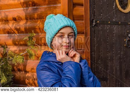 Portrait Of A Teenager In A Hat. Girl In A Blue Jacket Winter. Girl In A Blue Jacket For A Walk.