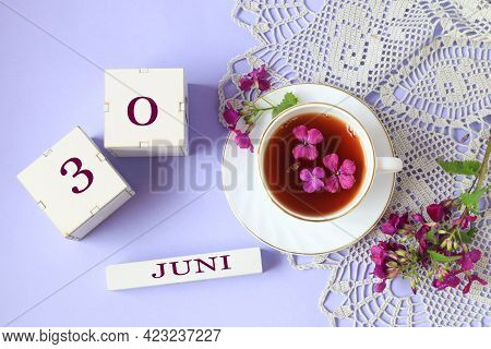 Calendar For June 30: Cubes With The Number 30, The Name Of The Month Of June In English, A Cup Of T
