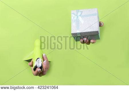 Toys For Adults In Beautiful Female Hands On A Green Background. Gift For Adults.